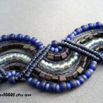 Handmade macrame bracelet in blue and gray